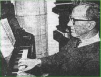 George Wainwright playing the organ, built in 1911 at a cost of £132 - click for full size image