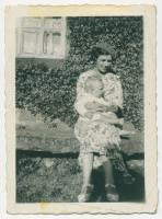 Dorothy Vivien Wray (Ne Breaks) 1908-2002, with her only son Maurice Edward Wray (B-1934) sitting on the 'Bink' or stone seat which was then outside the front of her grandfather's house. - click for full size image