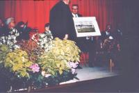 A framed picture of the Hall being presented to Ralph Robinson at the time he stepped down as chairman after many years of service. - click for full size image